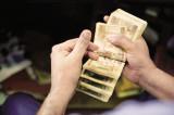 Rupee closes at 67.04 per US dollar