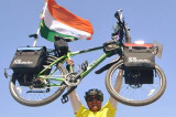 Bicyclist Sharma Travels the Globe to Highlight World Peace, Ecology