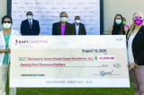 BAPS Charities Donates $25,000 in Support of Breast Cancer Victims