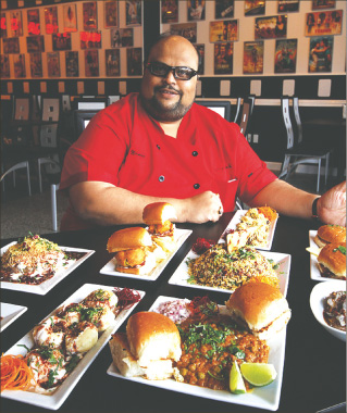 Chef Nirman Shah with the chaat spread at his new restaurant, Chowpatty Chat in Sugar Land