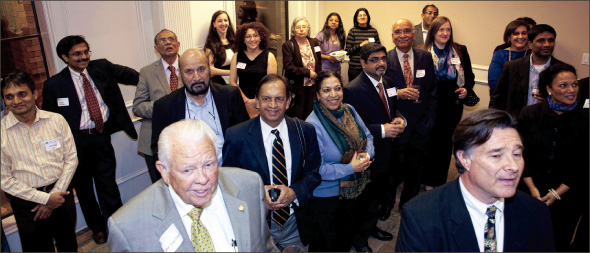 An audience composed of special guests, media and law firm staff cheer the expansion of the firm.