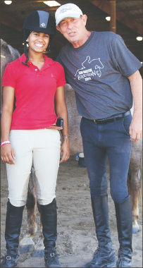 Kavita and her current trainer, Larry Smith at a horse show in Katy.