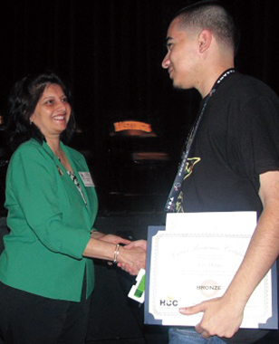 Hcc Trustee- District VII, Neeta Sane awarding a Career Readiness Certificate to a student