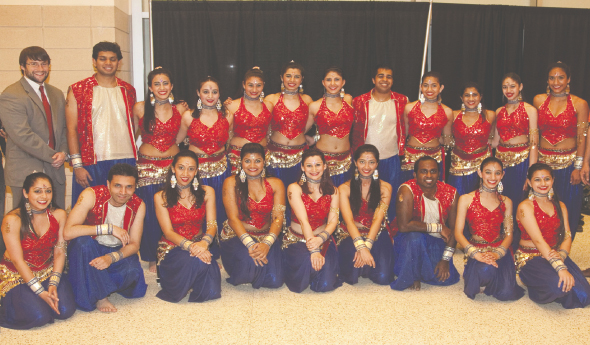 Arzan Gonda (center first row) with her Rhythm India dance troupe after their performance at the Toyota Center last Friday, April 12. John Donovan with the Toyota Center is on the upper left. Photo: Navin Mediwala.