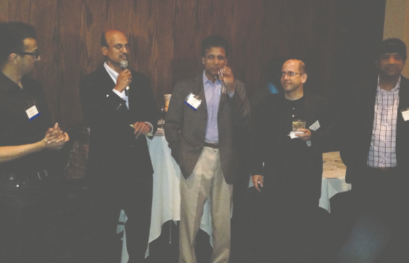 TiE Houston President Shri Iyer (on mic) flanked with Chapter Presidents at the networking event held on Wednesday, April 10 at Mangiammos on Post Oak.