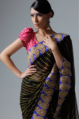 A model showcasing a black Lehriya Saree from the Aura collection.  Photo: Brian Styles