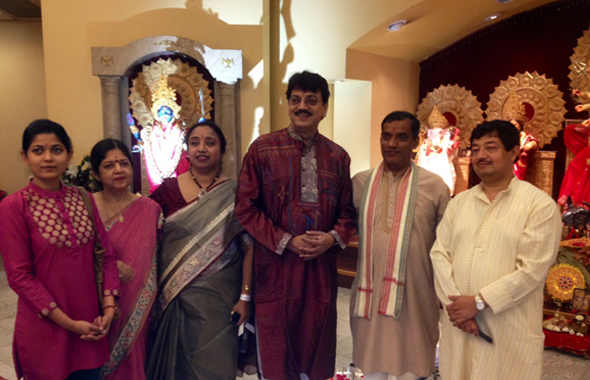 Chiranjit Chakraborty (center) doing Puja with Family.