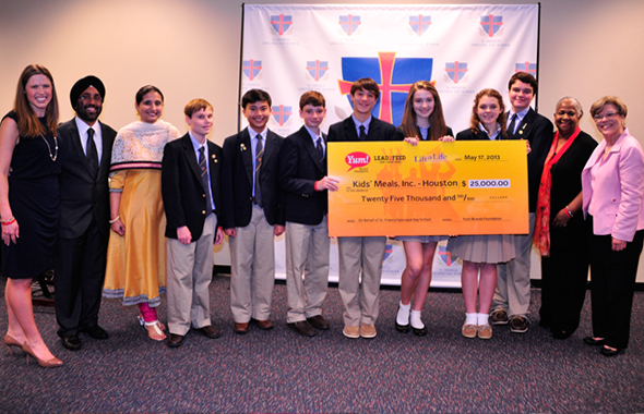 Ashley Butler, Director of Lift a Life Foundation, left, presents the winners from St. Francis Episcopal Day School in Houston with a $25,000 grant after taking first prize for the Lead2Feed World Hunger Leadership Challenge on Friday, May 17. Next to her are Dev and Jasdeep Lamba who helped coordinate the efforts with the students of KLI School in Meerut with Skype.