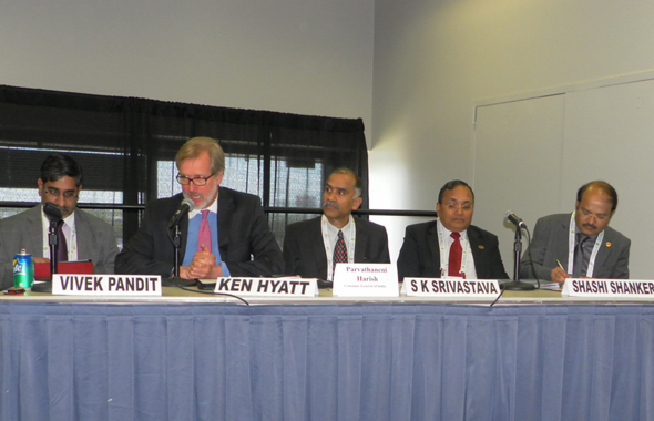 The panelists at the Federation of Indian Chambers of Commerce and Industry workshop held at the Offshore Technology Conference on Tuesday, May 7 at Reliant Arena. From left: Vivek Pandit, the Senior Director and Head for Energy at FICCI;  Ken Hyatt, the Acting Deputy Under Secretary for the International Trade Agency of the US Dept. of Commerce; Indian Consul General Parvathaneni Harish; S. K. Srivastava, Chief Managing Director, Oil India Ltd. and Shashi Shankar, Director, Oil and Natural Gas Corp.   Photo: Jawahar Malhotra