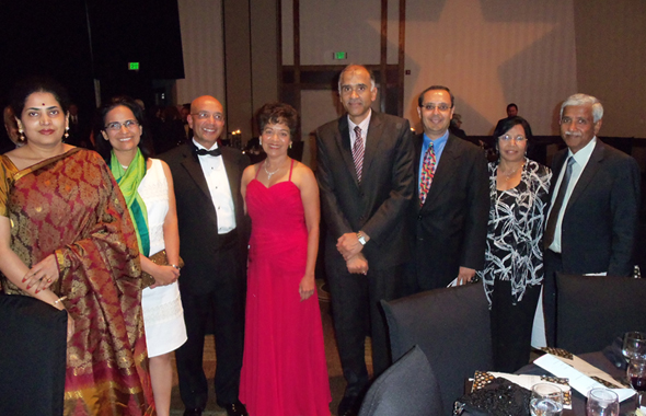 From left: Nandita Harish, a guest, 2013 Honoree Vijay Goradia, Marie Goradia, President , Pratham Houston, Indian Consul General P. Harish, Pratham USA President Atul Varadhachary, Bimal Jain and her husband Swatantra Jain, previous President , Pratham Houston.