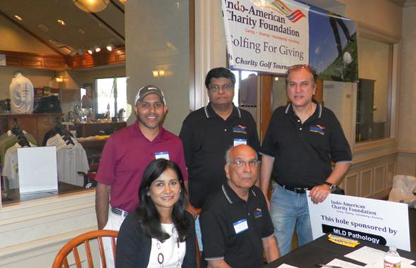 IACF Directors (from left) Anu Bala, Ajay Jain, Surender Talwar and Jawahar Malhotra with President Murthy Divakaruni (center standing) at the registration desk.