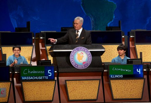 n this image released by National Geographic, National Geographic Bee winner Sathwik Karnik, left, of Massachusetts gives a thumbs-up as he correctly answers the final question posed by moderator Alex Trebek in Washington, on Wednesday, May 22, 2013. Runner-up was Illinois' Conrad Oberhaus watches at right. Photo: National Geographic, Rebecca Hale