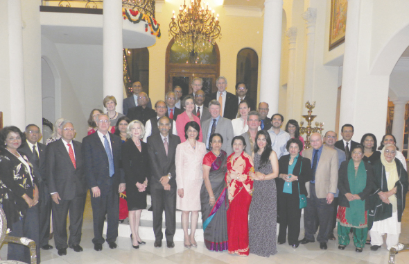 The guests and speakers mingled for a group picture at the ceremony at Dr. Arun and Vinni Verma's house on Thursday, April 25 in appreciation for their donation of $100,000 to the Foundation for India Studies program at the University of Houston.              Photo: Jawahar Malhotra