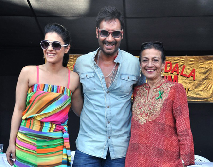 Kajol (l-r) is seen with husband Ajay Devgn and mom Tanuja at a fun fair to promote a green initiative in Lonavala, India May 11. (Manav Manglani photo) Read more at http://www.indiawest.com/news/10918-kajol-waiting-for-right-script-to-return-to-films.html#qf01c2JCuQzABvJZ.99
