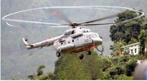 An IAF helicopter MI-17 V5 during rescue operation in Gauchar on Tuesday. (PTI Photo)