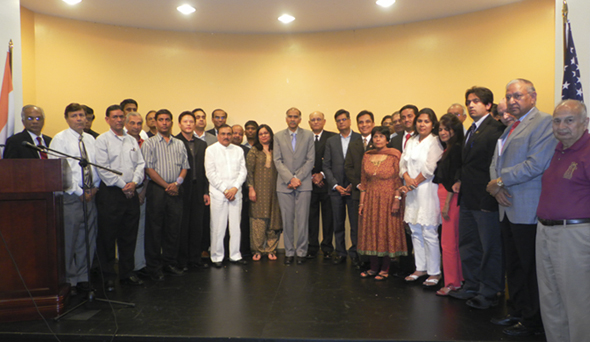 The leaders of the different Indo American organizations with the Indian Consul General P. Harish (center in suit) next to Sugar Land Fire Chief Juan Adame (in black uniform).         Photos: Jawahar Malhotra