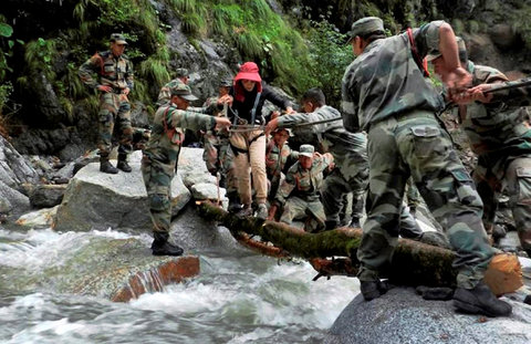 Army soldiers rescuing a woman at Pindari glacier in Uttarakhand, on Thursday