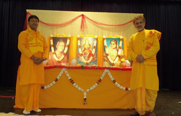 The two visiting volunteers Raj Pushkar Singh and Onkar Lal Patidar (with beard) on stage at the Gayatri Maha Yagya held at the ISKCON events hall last Saturday, July 6.