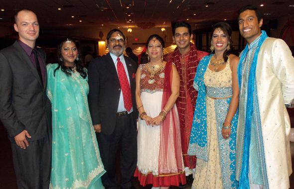 "Sameet ""Sam"" and Indira ""Ann"" Bhushan flanked by their family at the 35th wedding anniversary celebration held last Saturday, July 6 at Milan Banquet Hall in Little India. From left, James Anderson with his fiancé Reena Bhushan; Sanjay Bhushan; Sonia Bhushan and her husband Raj Singhal."
