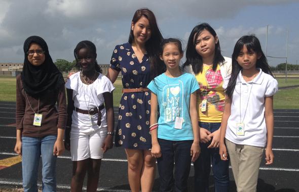 Children's Activities Intern Megan Nguyen (third from left) with students of the Alief ISD summer program.