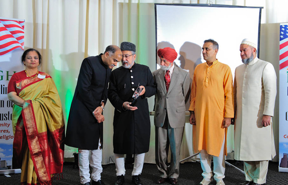 Emcee Dr. Zishan Samiuddin with the IMAGH Board and Col. Raj Bhalla who received a Community Service Award.