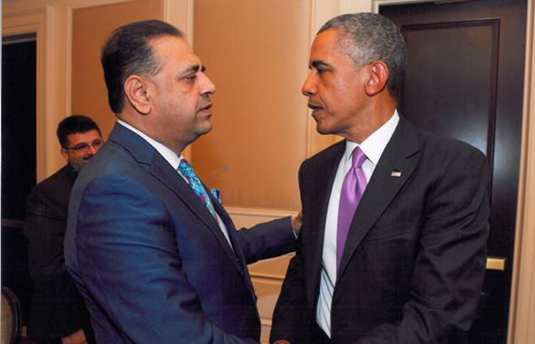 Houston businessman Lutfi Hassan meeting President Barack Obama at a business roundtable discussion on Thursday, July 11 at the White House.