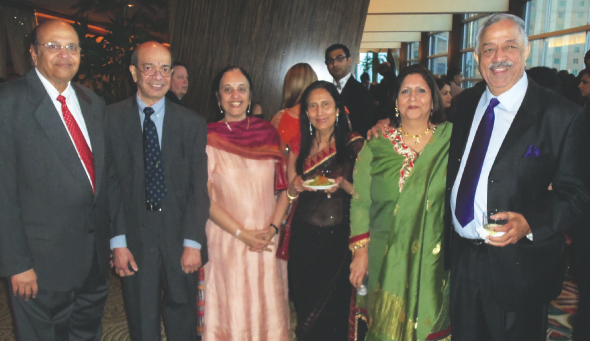 During the social hour, previous presidents Jagat Kamdar (left) and Kamna Sharma (2nd from right) with their spouses and guests Panna and Hiren Bhatia.