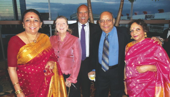Previous president Leela Krishnamurthy (right) poses with her husband Nat and guests.