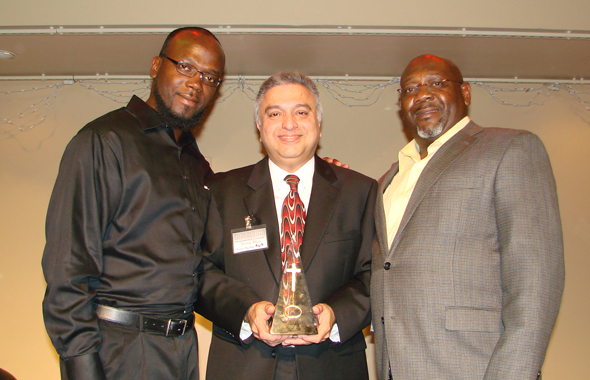 Nozer Buchia receiving the Distinguished Entrepreneur award from Barrim Clifton (left), President and Richard Singleton, Vice President of the Leadership Academy of the Carol Vance Unit.