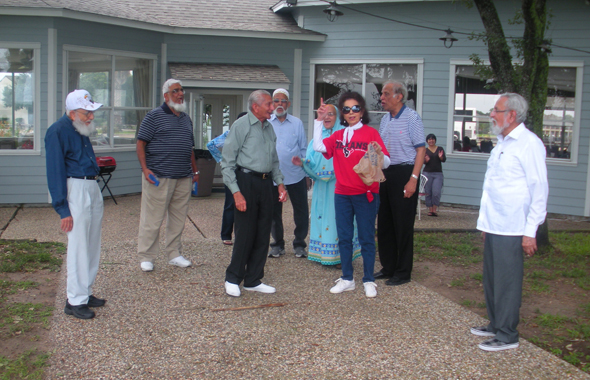 Volunteer Rahat Kalle with Members Taiyeb Shipchandler,Kamaruddin, (oldest members of Club 65) planning a walk.