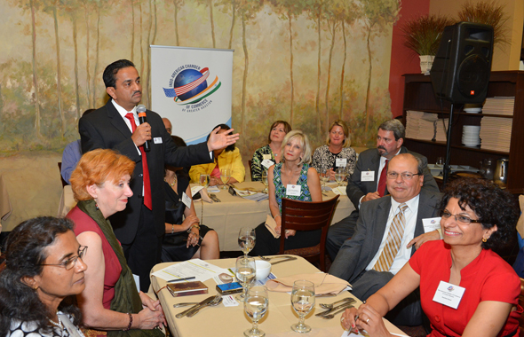 Pankaj Dhume, President IACCGH addressing the audience which included Board members and President Keri of the Fort Bend Chamber, Becci Himes of the British American Business Council  and the President of the Indian Cancer Network IACAN Kanchan Kabad.        Photos: Bijay Dixit