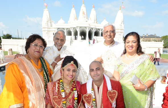 The newlyweds with their parents after the wedding ceremony at the BAPS Shree Swaminarayan Mandir.