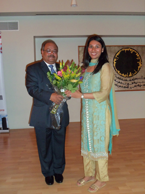 IMAGH President Latafath Hussain presented a bouquet to Saleena Jafry at the presentation held at the Jamatkhana.Photos: Jawahar Malhotra