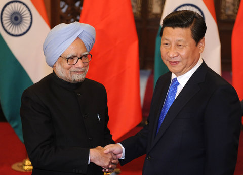 Manmohan Singh, left, prime minister of India, with Xi Jinping, president of China, in Beijing, China, on Oct. 23.