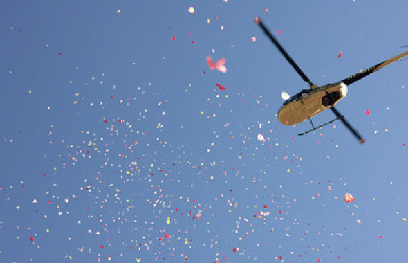 Flower Petals being showered from a helicopter at the time of Kumba Sthupi