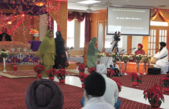 The sanctuary of the Sikh Center was colorfully decorated with red poinsettias in the aisle.  Photos: Jawahar Malhotra