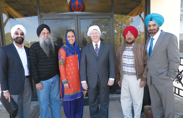The Board of the Sikh Center escorted Judge Ed Emmett to the sanctuary. Bobby Singh (left) invited the Judge to the celebrations. Photos: Jawahar Malhotra