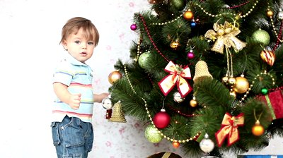stock-footage-baby-boy-near-a-christmas-tree