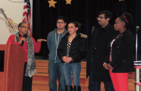 The math teacher Carmen Johnson with four of the eight mentors who tutor kids in the classroom.           Photos: Jawahar Malhotra