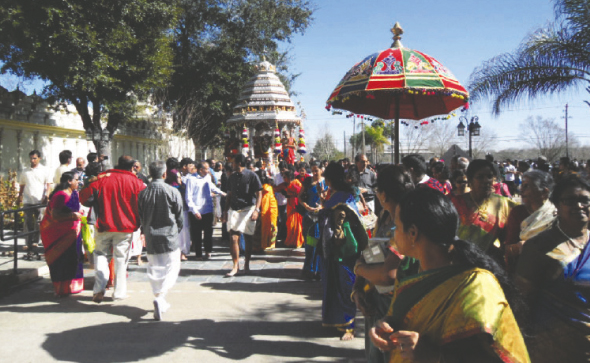 Ratha Yatra:  Deities resplendent on the silver chariot in procession around the Temple