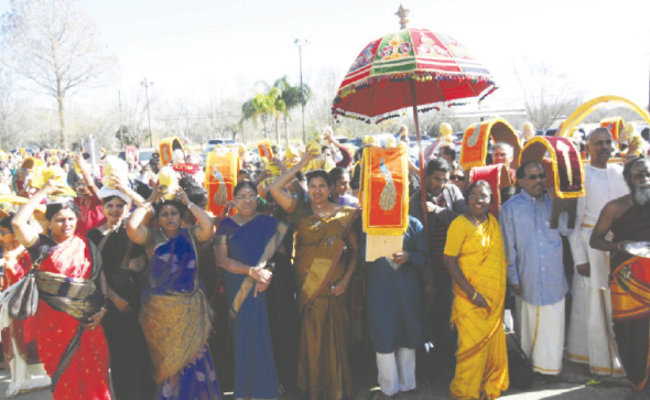 Devotees carrying Pal Kudams and Kaavadis in a sea of procession for the Abhishekam