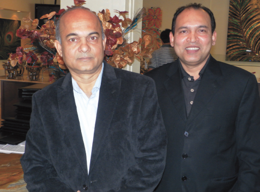 Nirvana General Manager Mansour Allam (left) with manager Mahmood Ahsan at the front entrance of the new location of the restaurant.