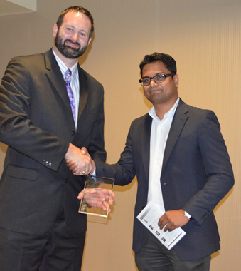 Karthik Balasubramanian receiving a Young Engineer of Year 2014 Award from Brent Baldwin, Houston Engineers Week Committee Member.