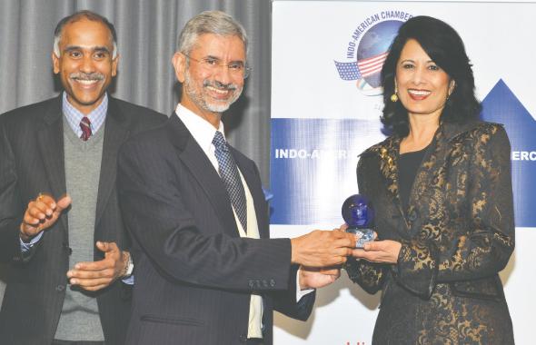 Indian Ambassador S. Jaishankar presents an award to University of Houston President Renu Khator as Consul General P. Harish applauds.