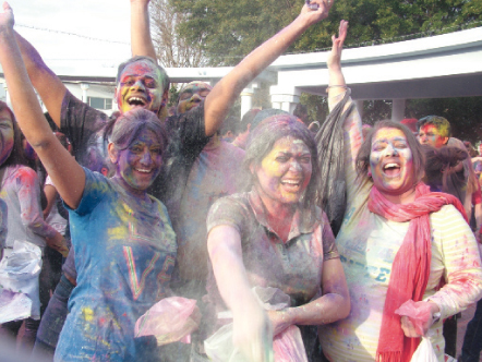 Attendees having fun during the Holi celebrations.
