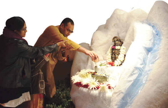 Family performing the Ksirabhiseka to the Utsava Linga. All the devotees had an opportunity to offer abhisekam with milk to the Utsava Linga.