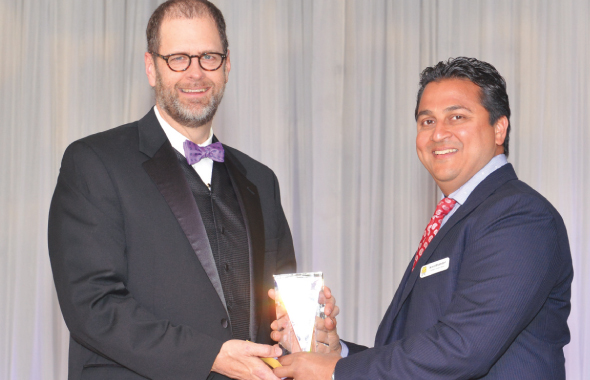 Gala Chair Amit Bhandari (right) gives a trophy to Keynote Speaker Leo Linbeck, III.                                                              Photos: Bijay Dixit