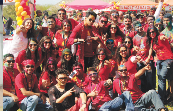 Masala Radio crew with pop star Raghav (front, center) at the Holi Mela at Seabourne Creek Park on Sunday, March 30.