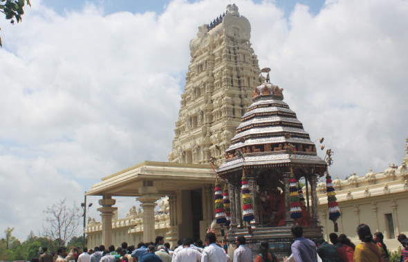 The majestic Raja gopuram raises behind the beautiful Silver Chariot on Sita Rama Kalyanam at Sri Meenakshi temple