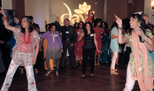 """Dance instructor Anjali Thakkar (far right) led gala enthusiasts, such as advisory board member Sheela Rao (far left), in disco dancing as part of the """"Dine and Disco for Daya"""" theme."""